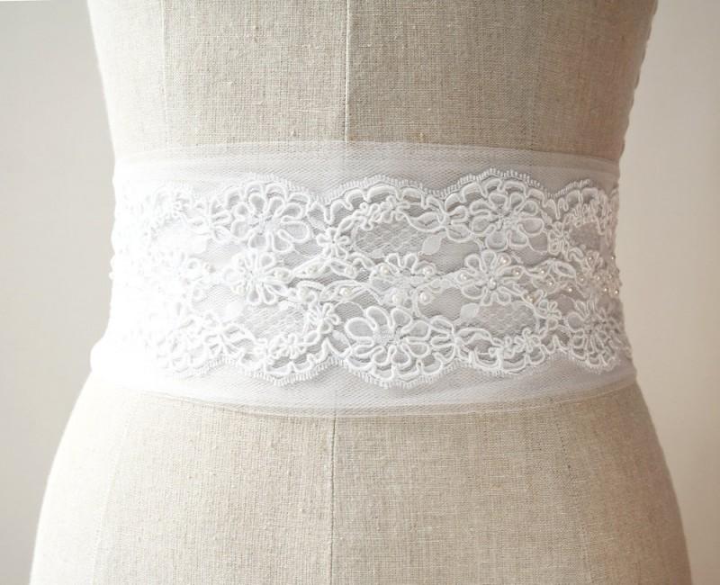 white tulle and lace | NEW Wedding Dress Sash Ideas via http://emmalinebride.com/bride/wedding-dress-sash-ideas/