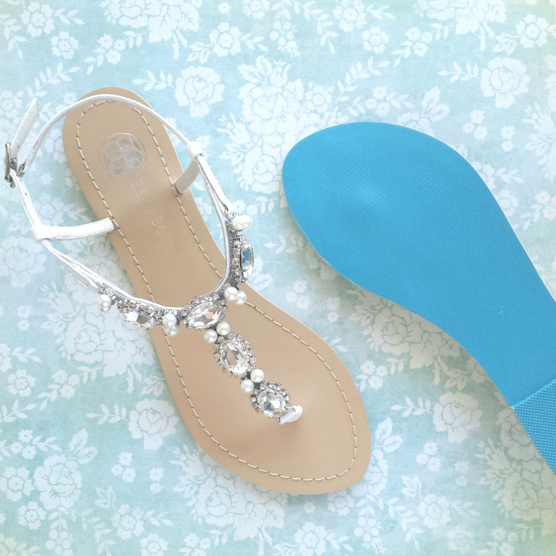 White white wedding sandals have a blue sole for an instant Something Blue. | via 31 Best Handmade Wedding Shoes http://emmalinebride.com/bride/handmade-wedding-shoes/