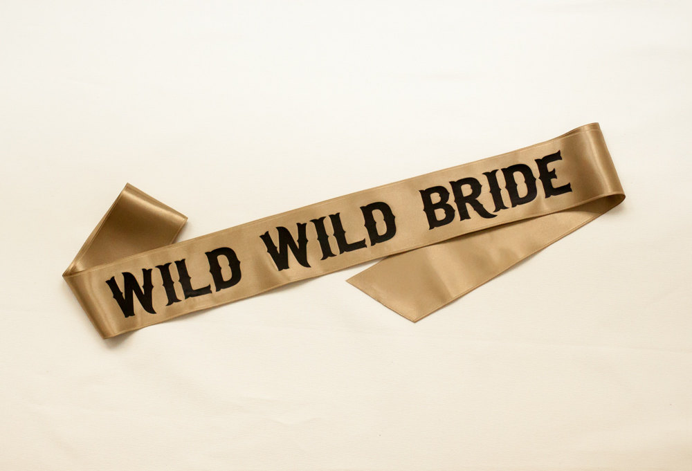 wild wild bride sash | stylish bachelorette sash ideas | via https://emmalinebride.com/bride/bachelorette-sash-ideas/