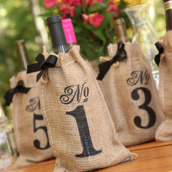 wine bottle table number bags made of burlap - wine themed wedding ideas