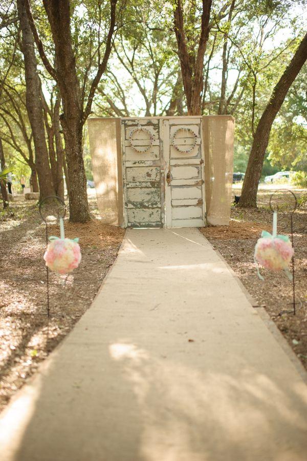 woodland ceremony idea | Ceremony Backdrops Doors | photo: Luminaire Photo