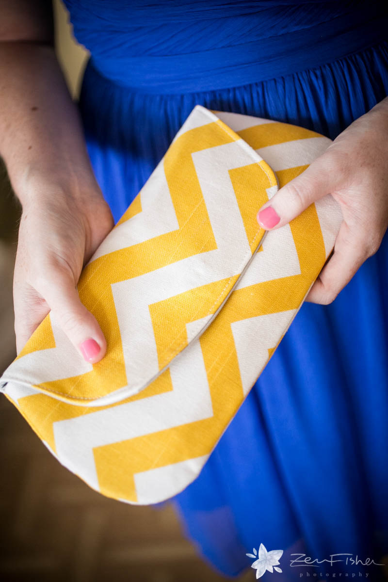 yellow chevron clutch purse | 7 Spring Wedding Clutches Your Girls Will Love via emmalinebride.com