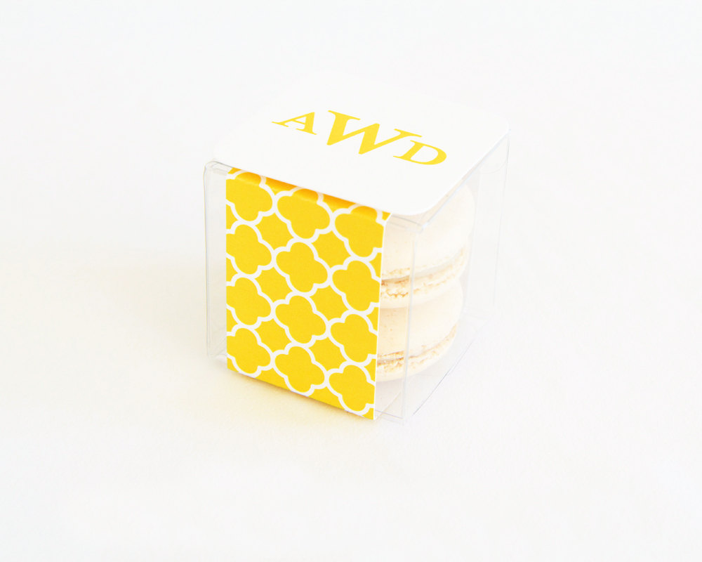 yellow quatrefoil macaron favor box | via 7 Things to Know About Giving Macaron Favors https://emmalinebride.com/favors/giving-macaron-favors/
