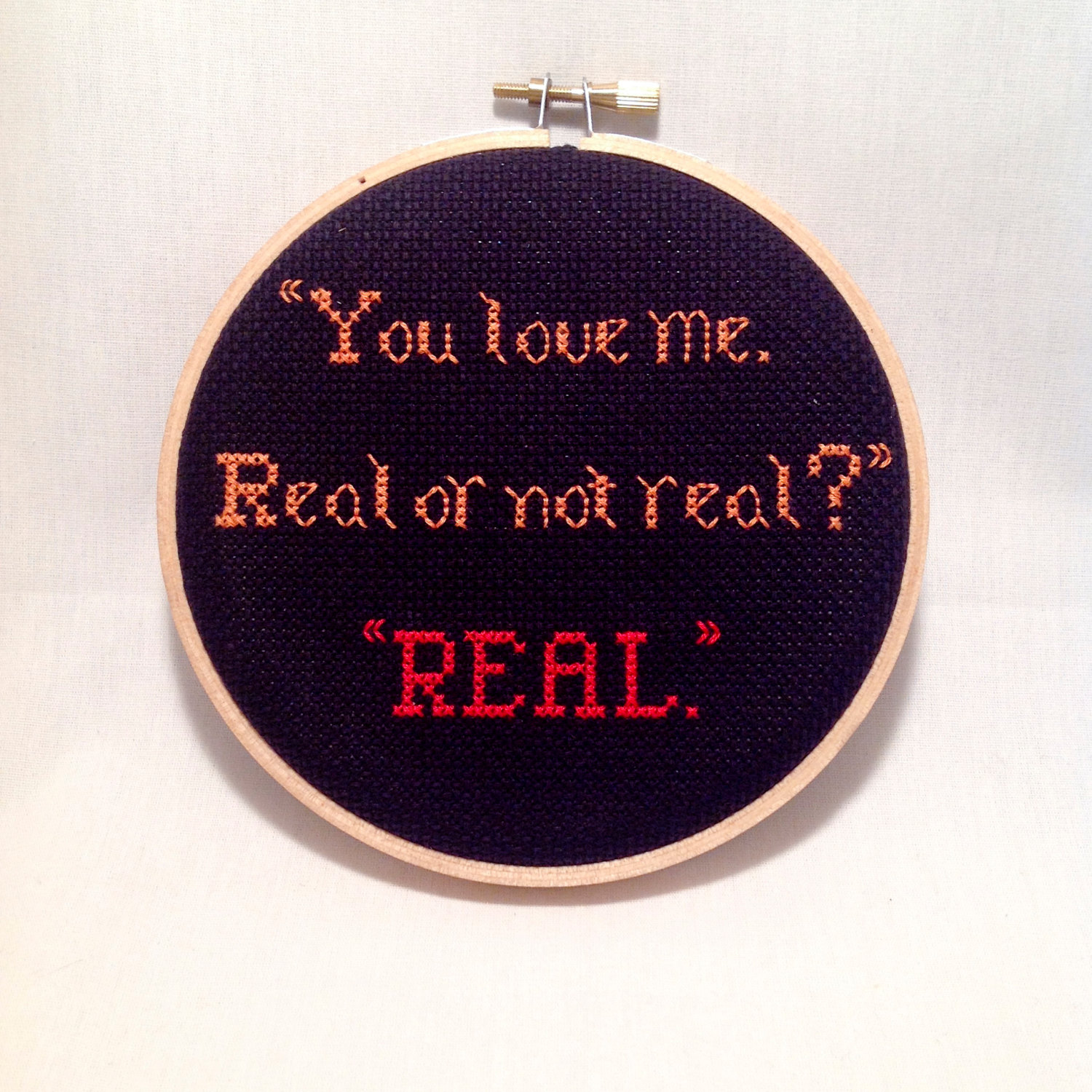 hunger games hoop art | via emmalinebride.com | 50+ Greatest Geeky Wedding Ideas of All Time